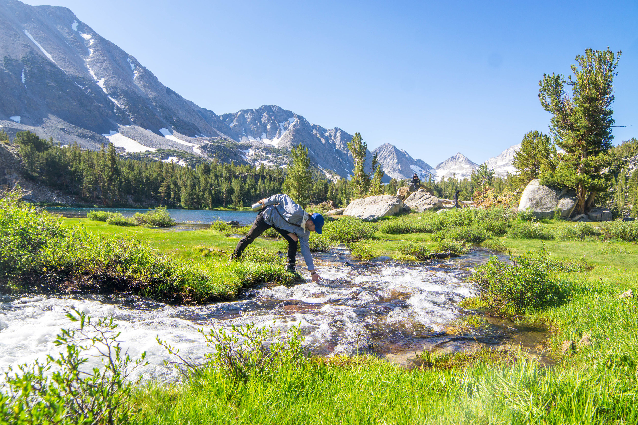 But like a scene out of Switzerland, lush meadows cut by alpine streams were rimmed by snowcapped peaks. The beautiful scenery made the battle with the mosquitos well worth it.