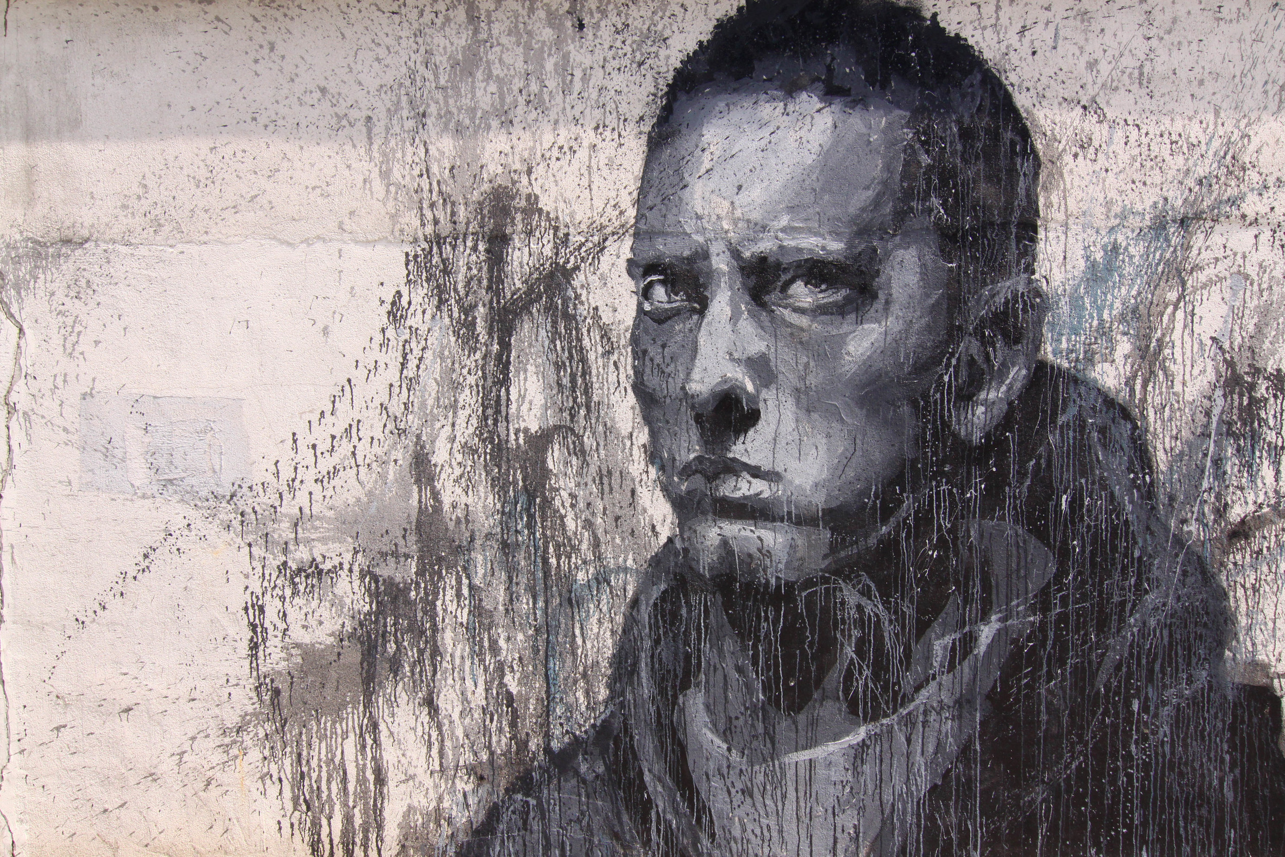 Eminem - The personification of the millennial evolution.His Slim Shady LP opened a culture dialogue, and ushered a new paradigm in how we look at the expression of white experience through the eyes of Hip Hop; Eradicating the barriers of racial intolerance and the stereo type that white rappers didn't belong in Hip Hop.