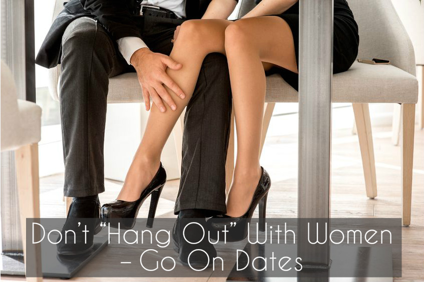 Man sensually touching a woman's leg under a table