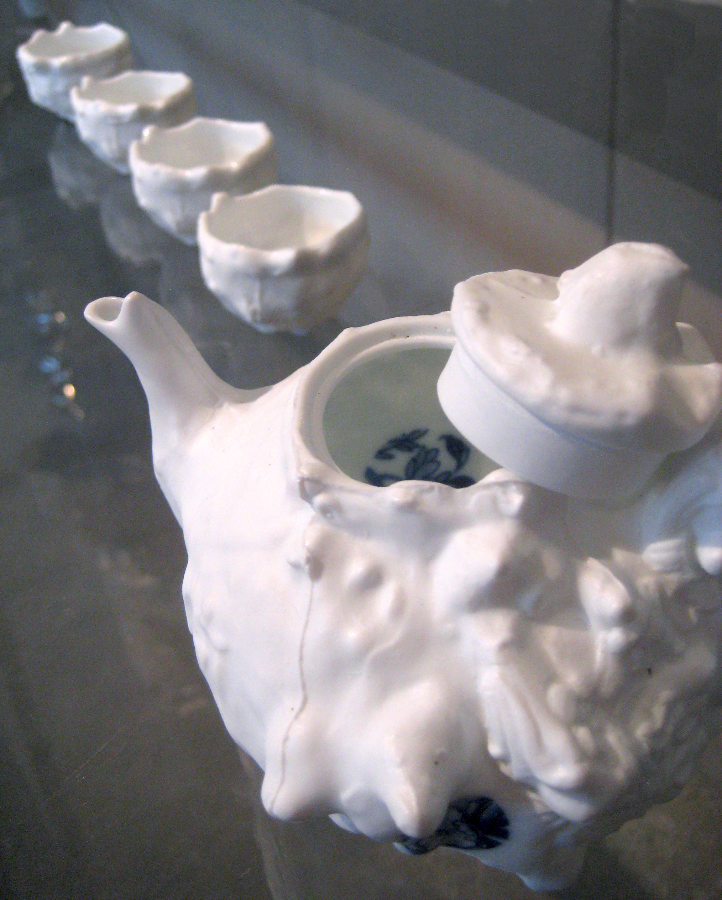 Porcelain, Ceramic decals    Factory teapot coated with layers of wax, etc. and the help of an unusually eager mold-maker