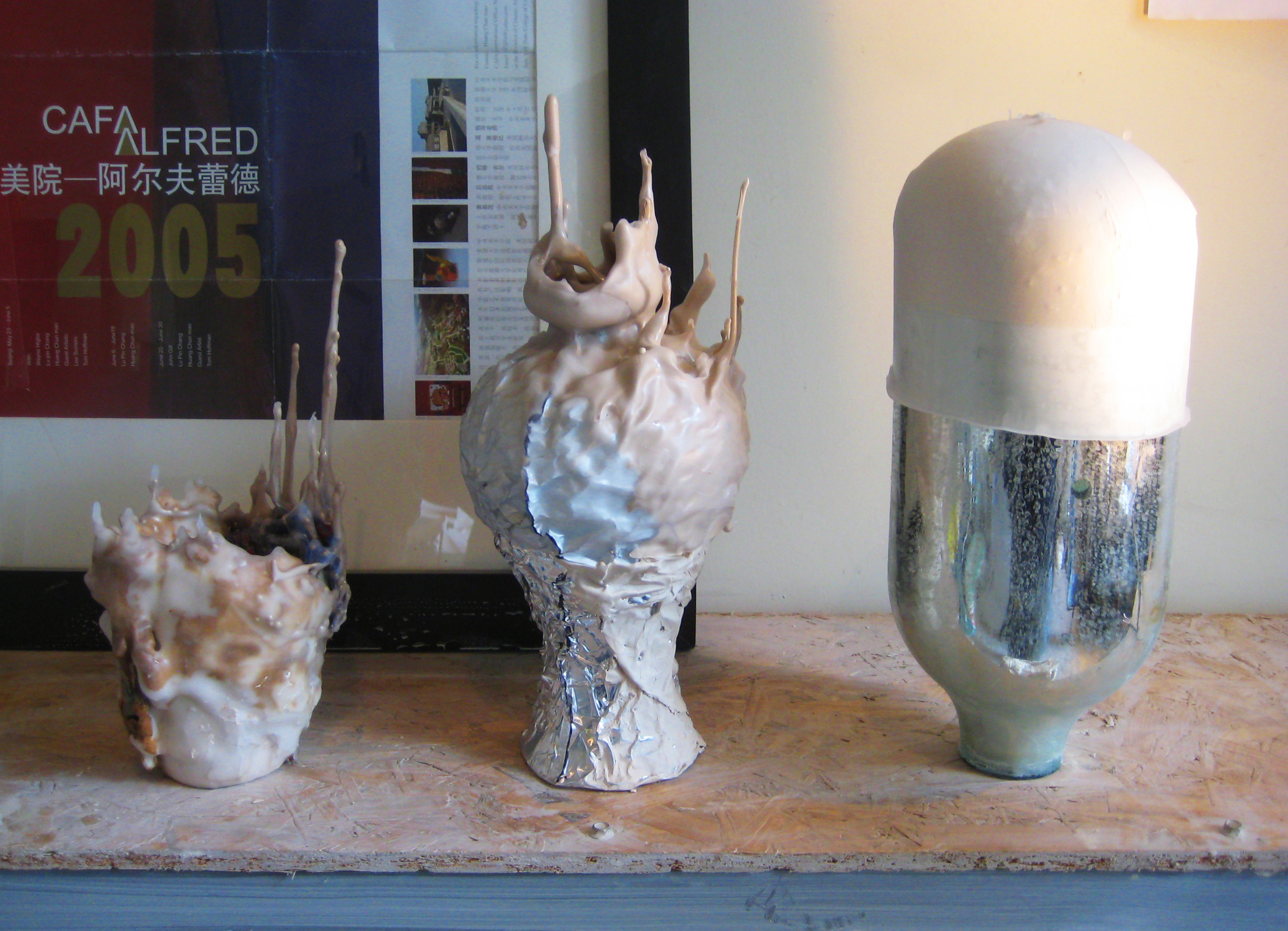 Unfired clay, wood    Found objects, casting slip, aluminum foil, wax