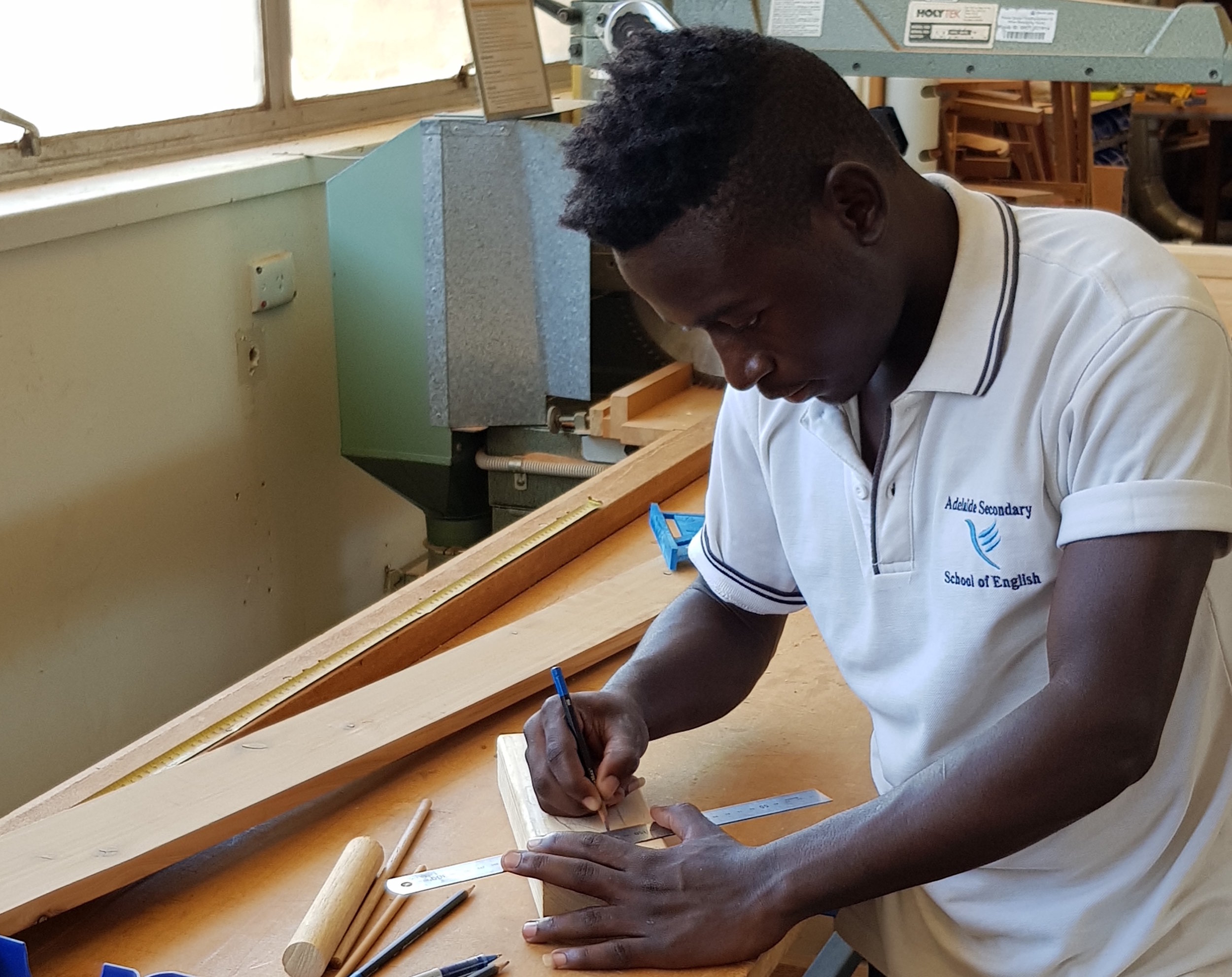 a student working in the school's tech studies facilities