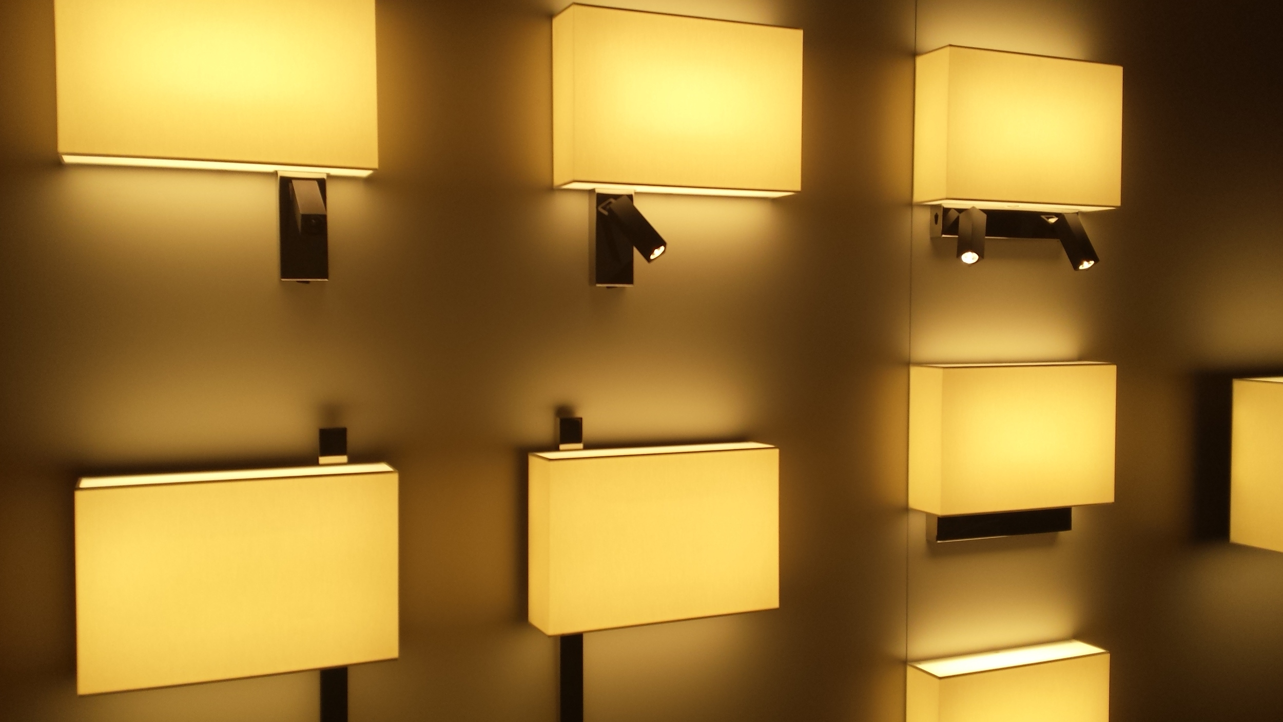 A selection of asymetrical wall lamps both with and without reading lights.