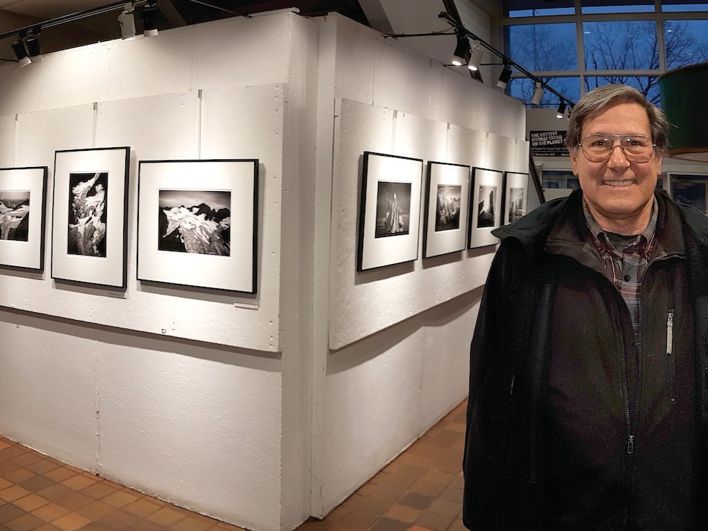 Ron Rosenstock in front of his exhibition at the Worcester JCC on Salisbury St.