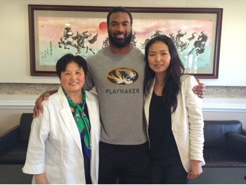 Zaviar Gooden with Acupuncturists Dr. Jin and Cameron Huh