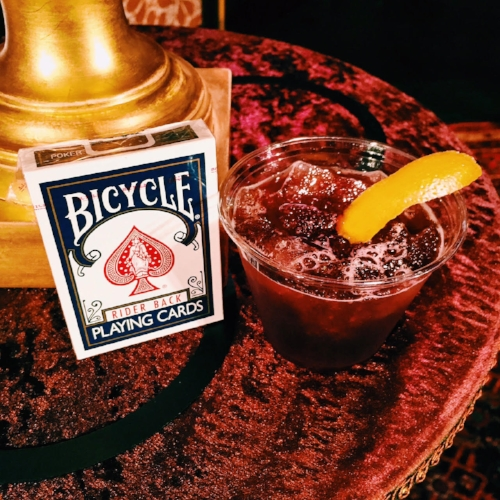 The Spirit Artist, a blend of Bourbon, cherry juice, orange peel, Demerara simple syrup, and chocolate bitters - magically delicious!