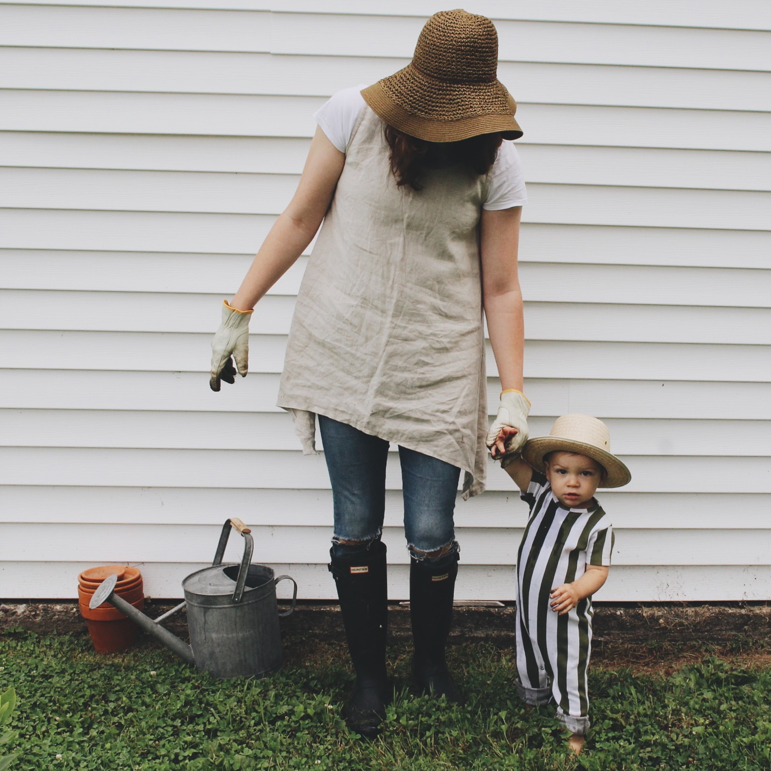 On Tad: Romper -  Tiny Cottons  ( @tinycottons ) c/o  Murray and Finn  ( @murrayandfinn ) // On Me: Sunhat - Urban Outfitters; Linen Tunic -  Under A Tin Roof  (@underatinroof); Wellies -  Hunter Boots