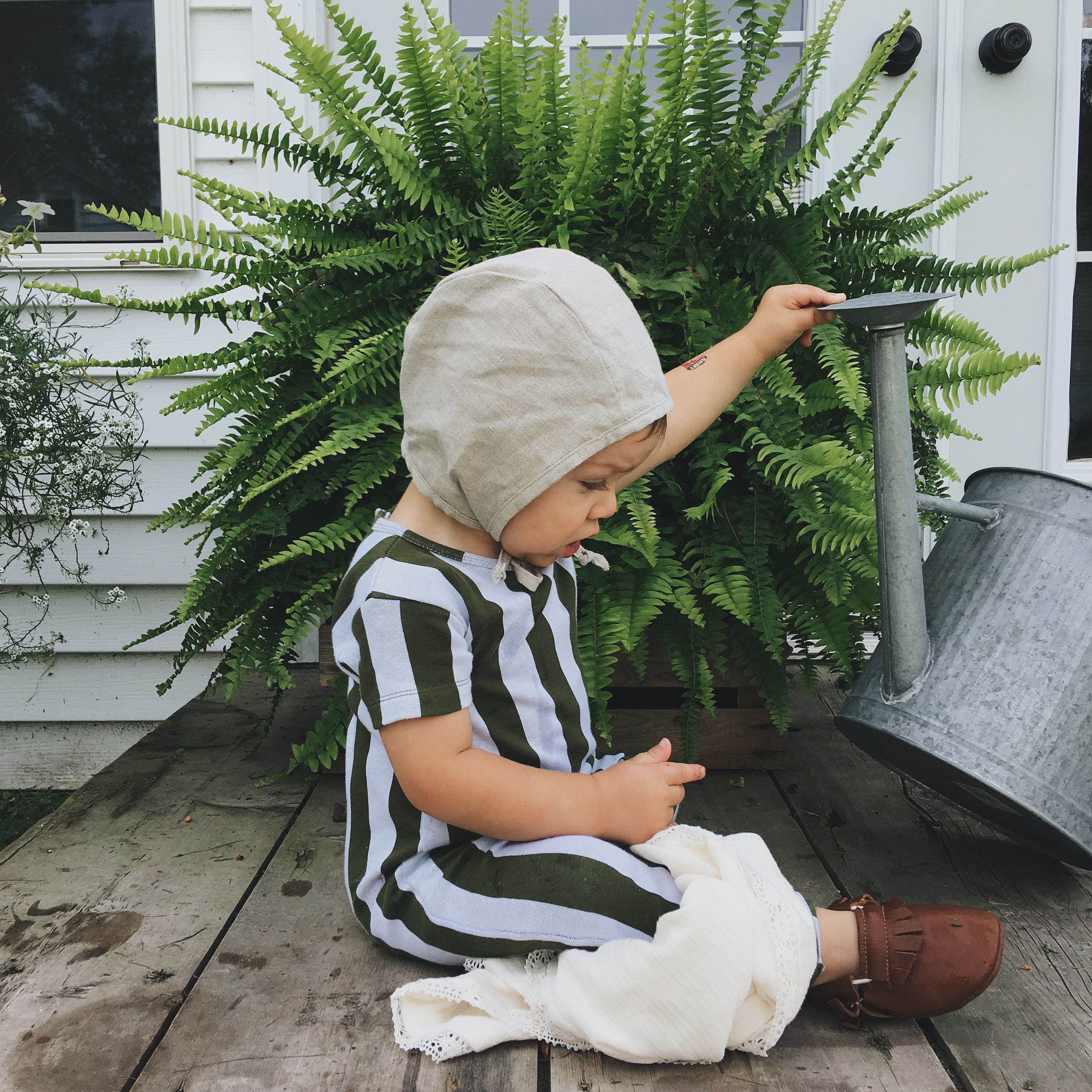Linen Bonnet -  Under A Tin Roof  // Romper -  Tiny Cottons  c/o  Murray and Finn  //  Moccasins  c/o  Ulla + Viggo