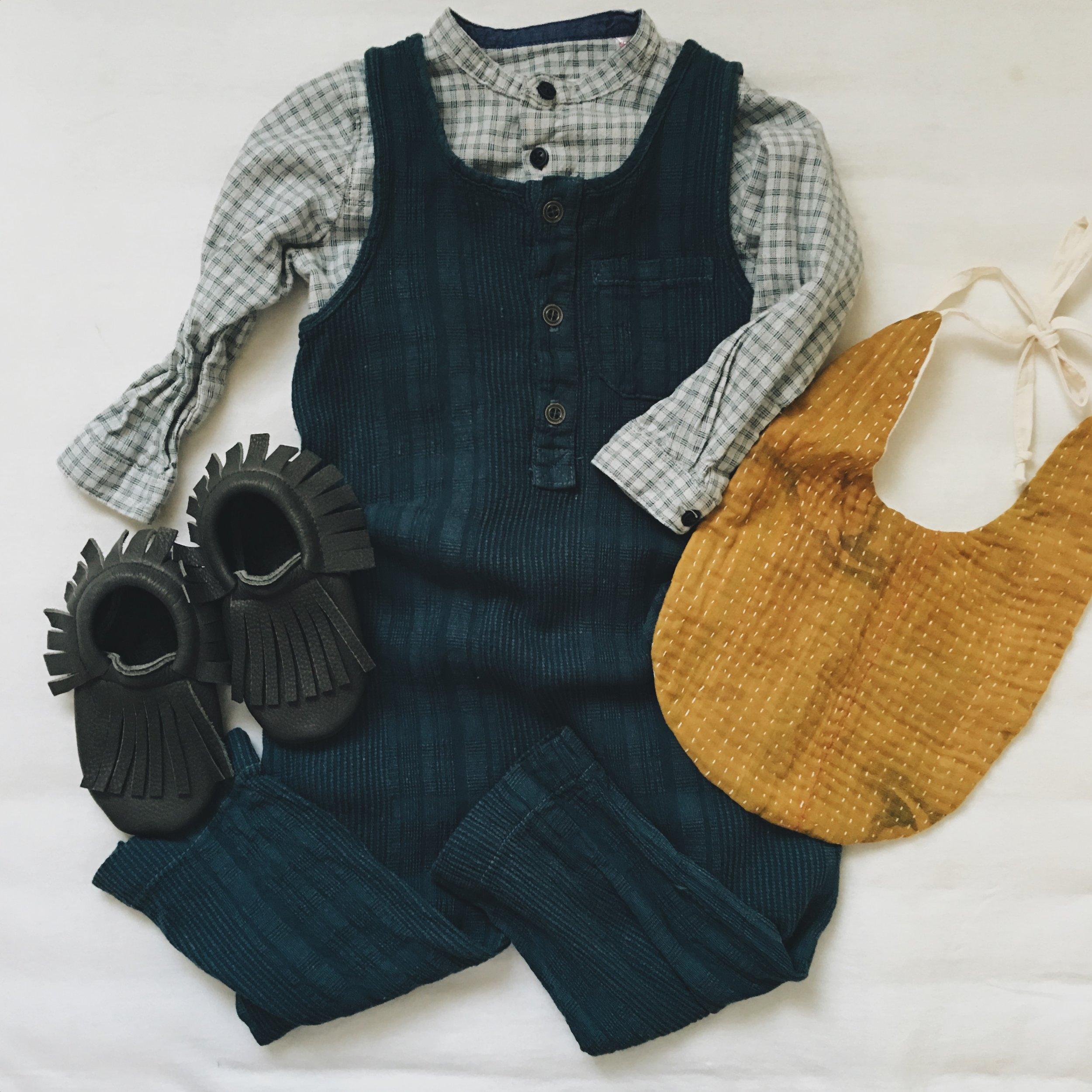 Romper -  Nico Nico Clothing  c/o  Murray & Finn  ; Plaid Shirt -  Zara  ; Bib -  Wild Winnie  ;  Raven Moccasins  c/o  Little Pine Outfitters
