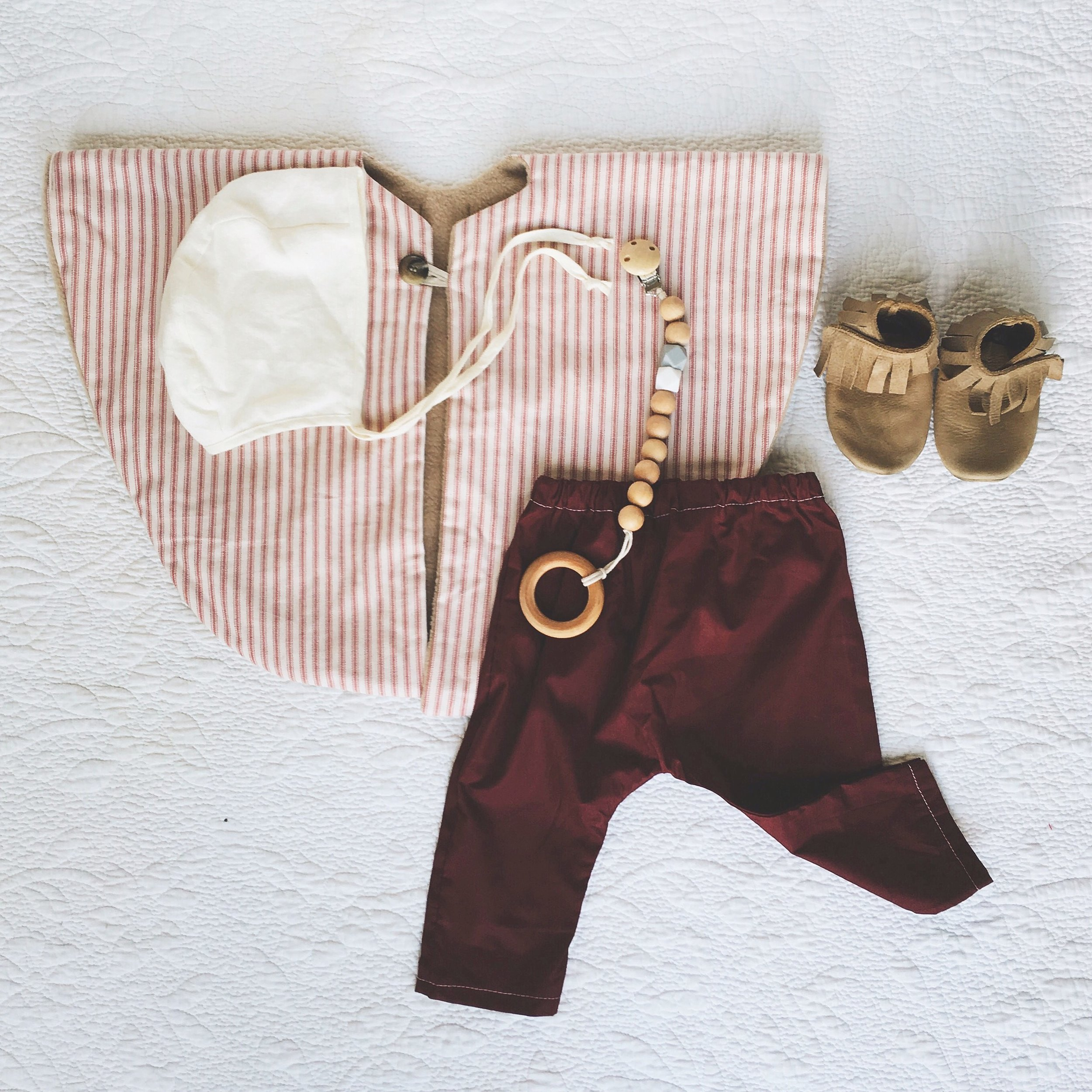 Fleece Cape c/o  Foothill Fawn  ;  Harem Pants  c/o  Little A Handmade  ;  Bonnet  -  Briar Handmade  ; Moccasins c/o  Ulla +Viggo  ;  Pacifier Clip  c/o  Wild Creek Co