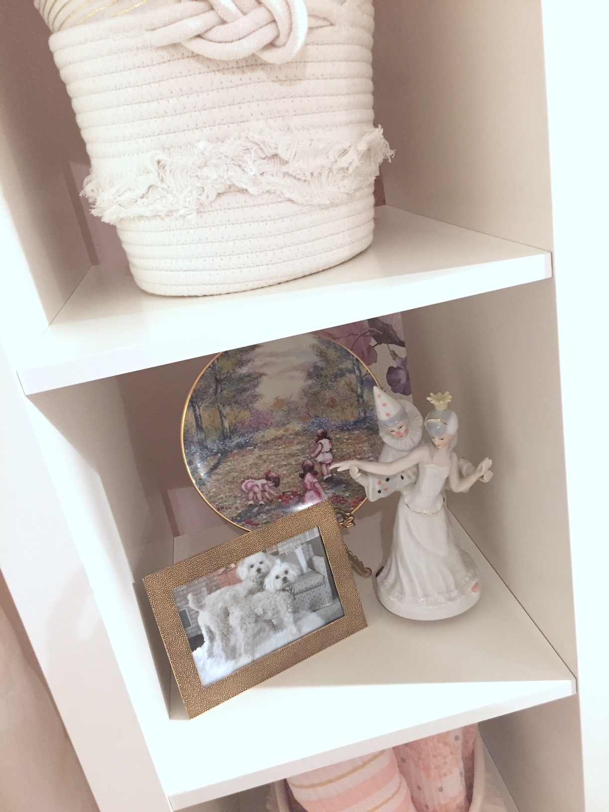 A shelf of memories holds a special plate that was given to my Mom when I was born and a music box figure that was given to me by my Aunt. Always find a way to add in the person details that make a space special.