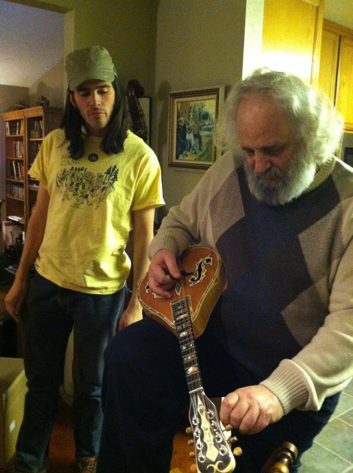 David Grisman showing Stash one of Ira Louvins' mandolins