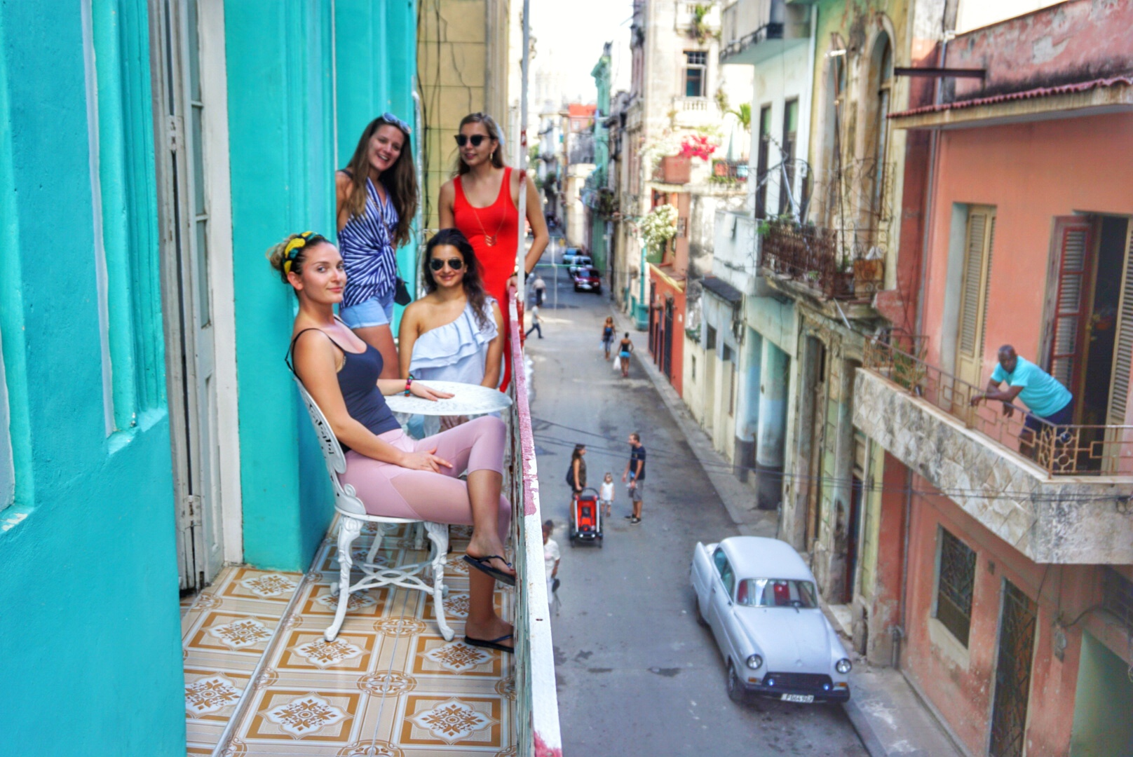On our balcony at the home of a local family in Old Havana. El Capitolio is in the background, which is currently being renovated (because the government is going to move in there, according to our local tour guide.