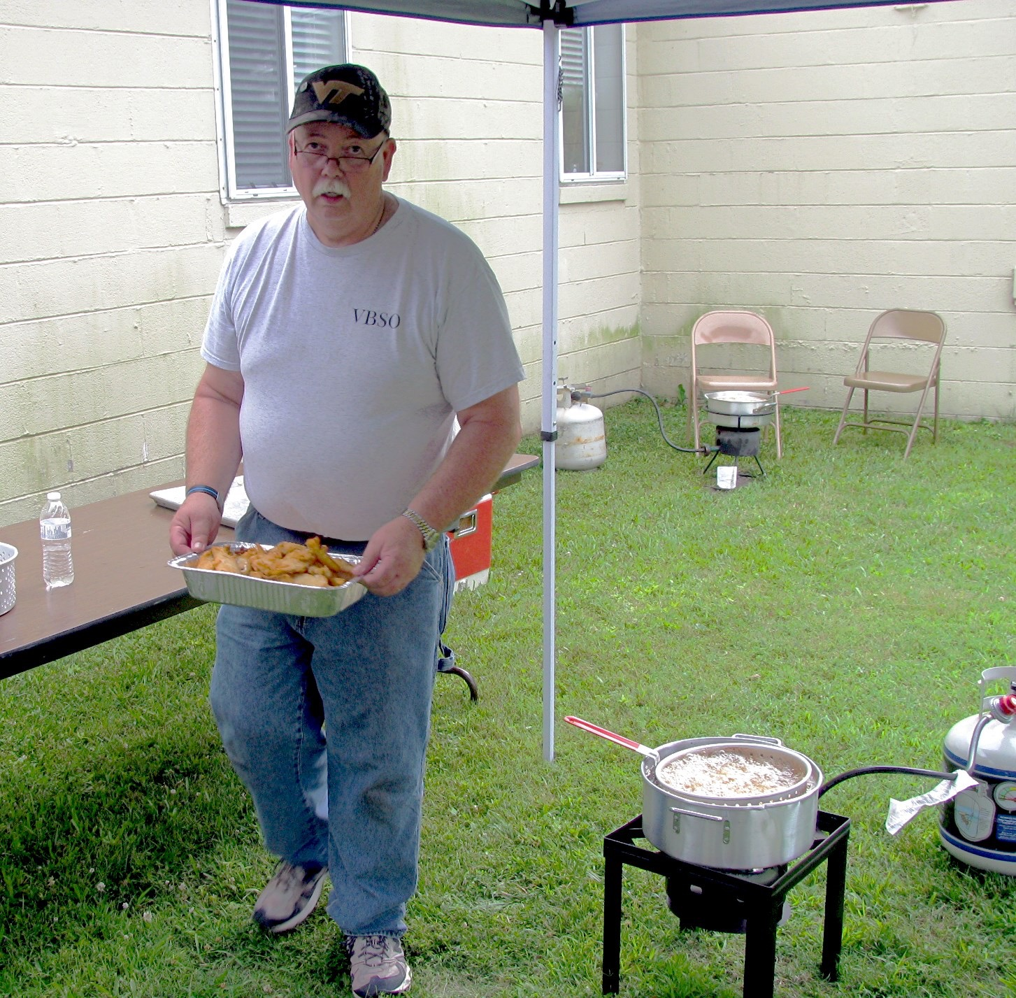 the men's church-wide community fish-fry - A man's work is never done!