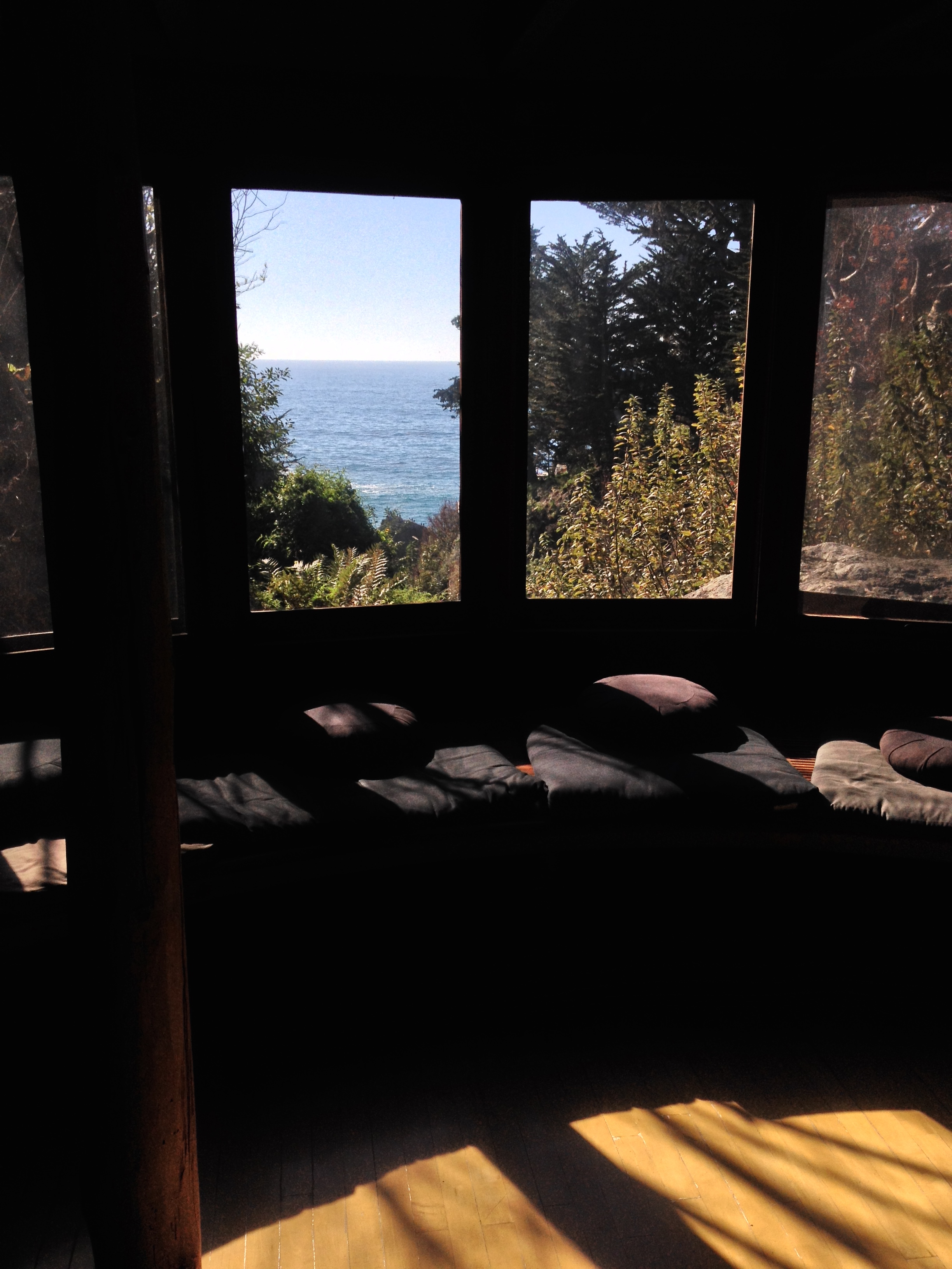 listen to the fast-moving stream heading toward the ocean in the meditation hut