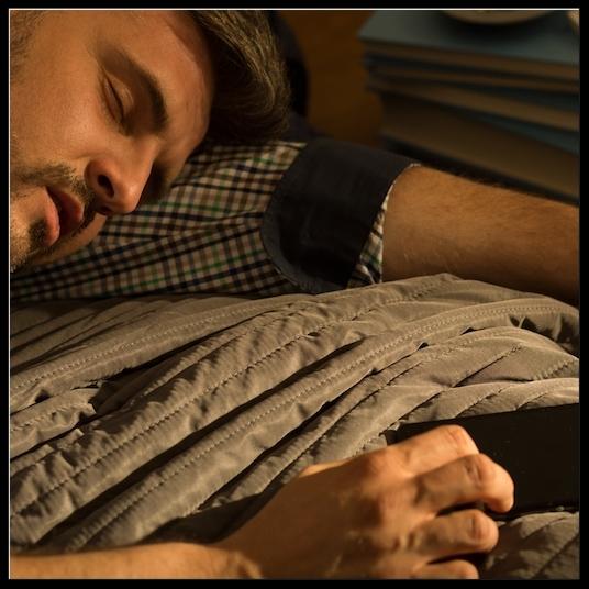058802030-man-sleeping-bed edited.jpeg
