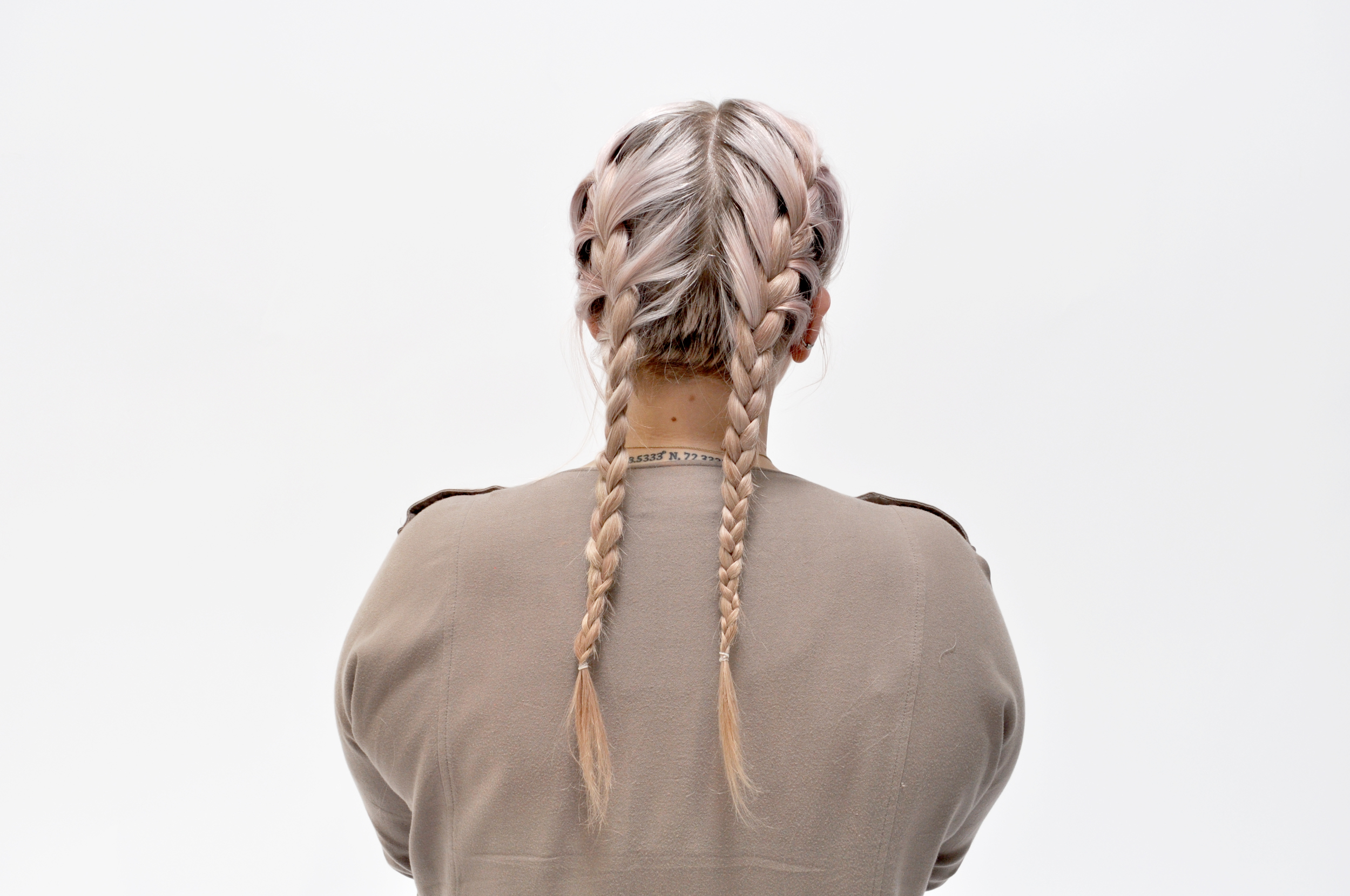 Once you have finished braiding on your head, finish the braid and tie it off with an elastic.Repeat on the opposite site, and TA-DA! You're a braid babe.
