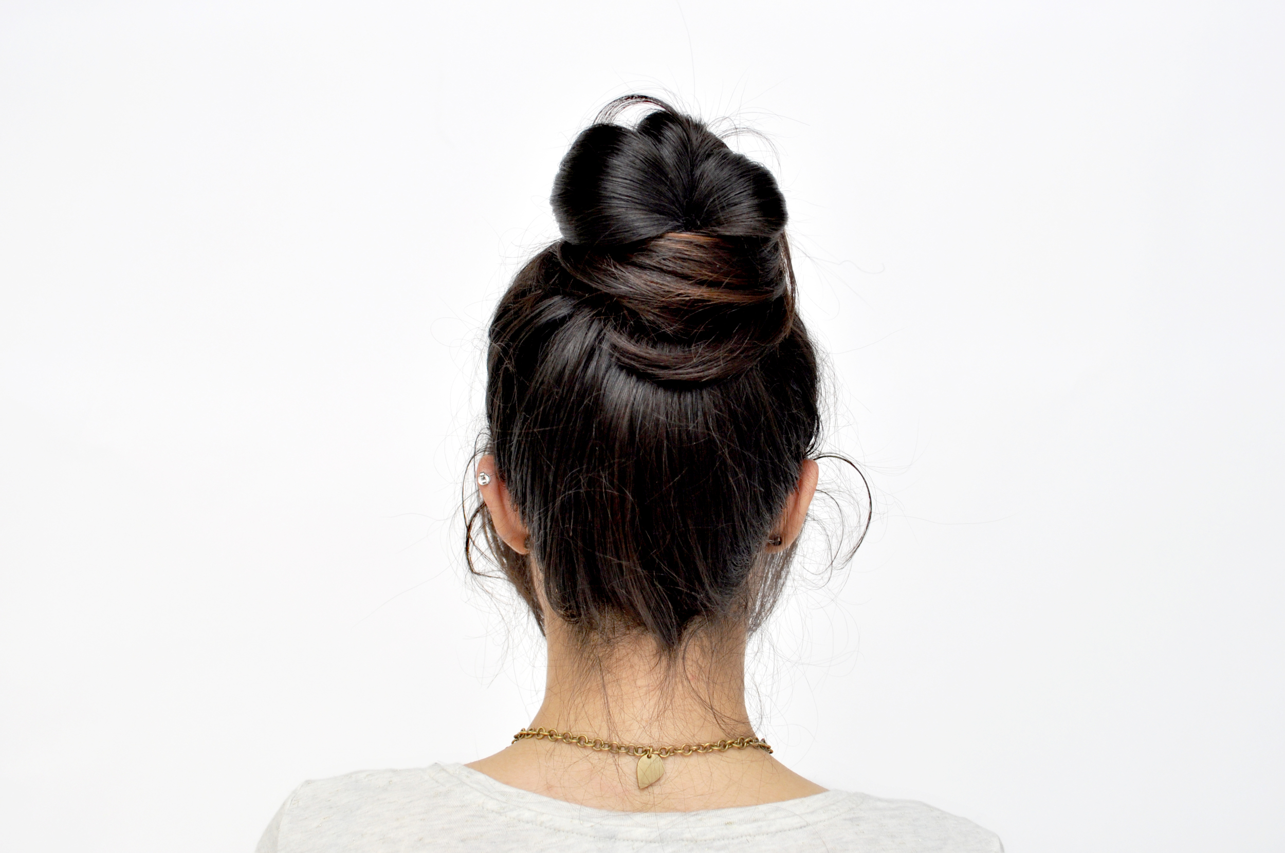 Take the other section of the pony and loosely wrap it in the opposite direction. Secure the end with a bobby pin.