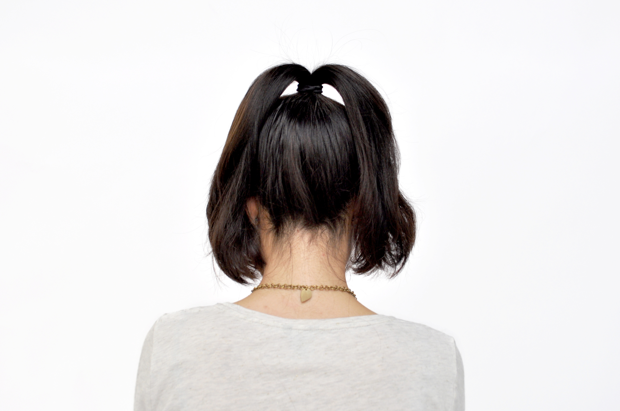 Split your pony into two sections.Tease your hair with the  Diane by Fromm Dual Teeth Teasing Comb  for a bun with extra volume and texture!