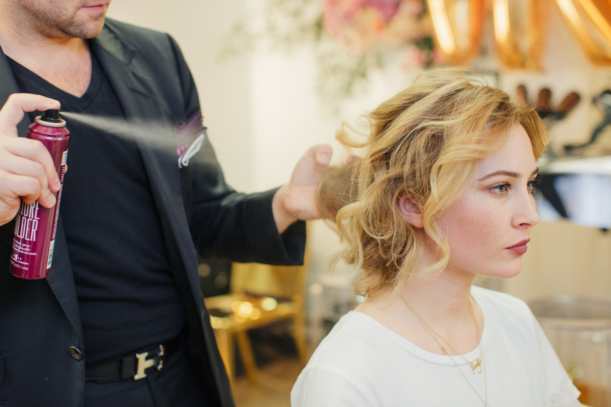 After you have finished curling, add  Matrix StyleLink Texture Builder about four to five inches away from the roots.