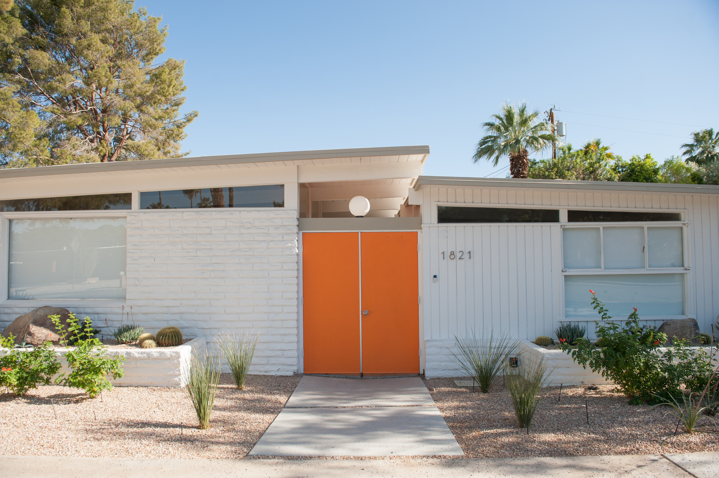 Orange doors welcome you in at The Amado.  I  mage courtesy of Melissa Gidney.