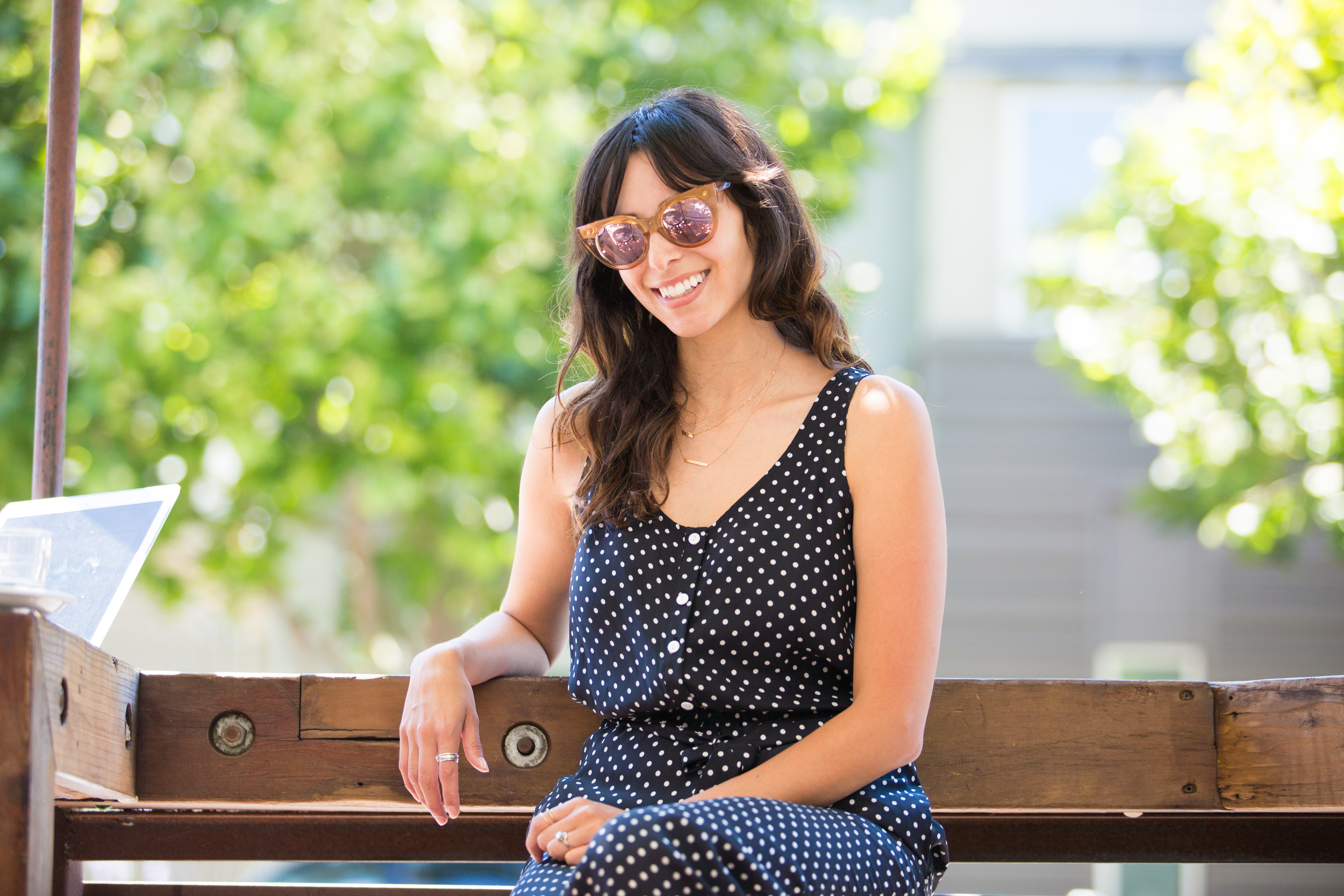 """""""Four Barrel is a great place to grab coffee, especially if you're going bar hopping after."""" Angela perched on the outside seating at Four Barrel."""