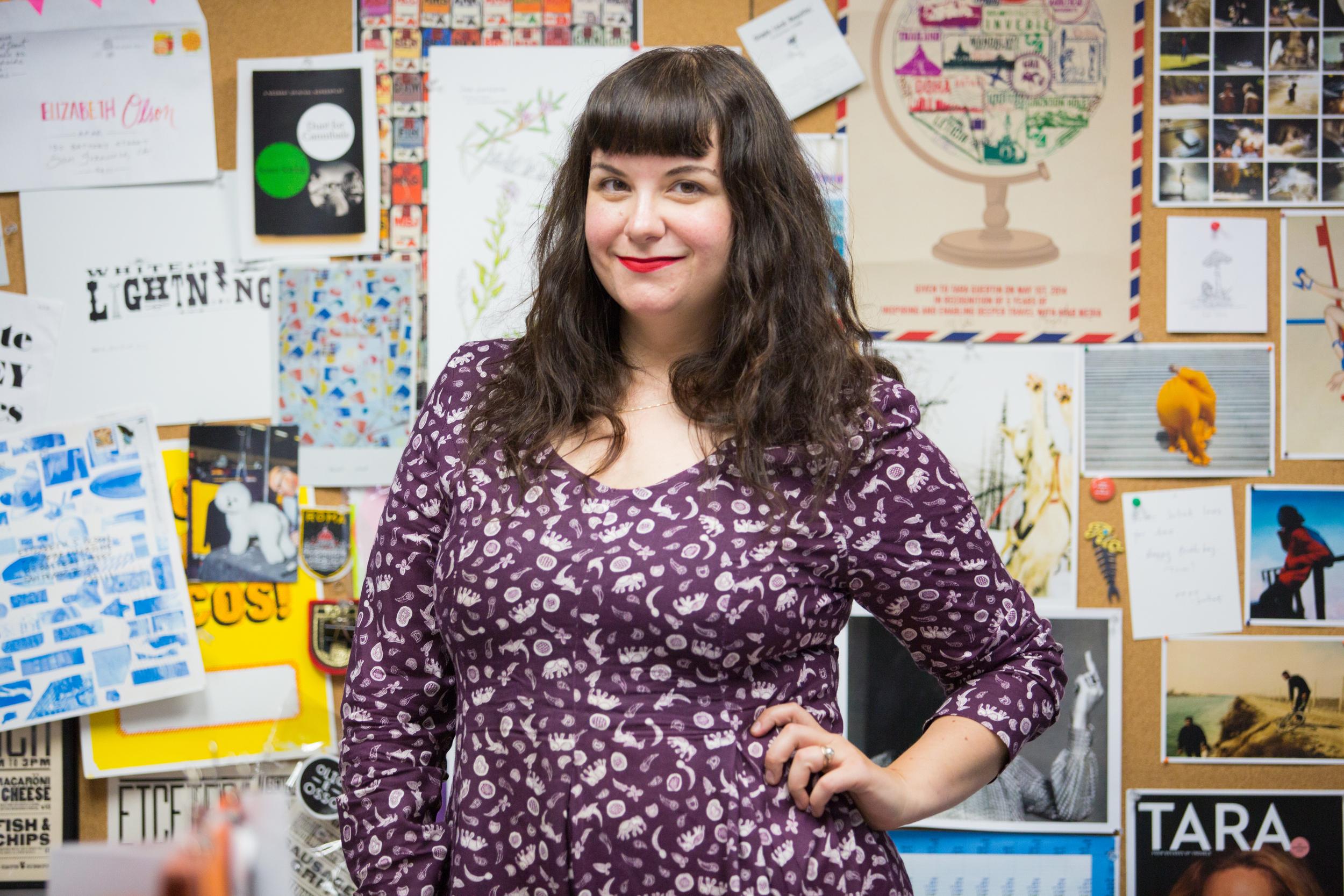 Elizabeth in front of her office mood board.