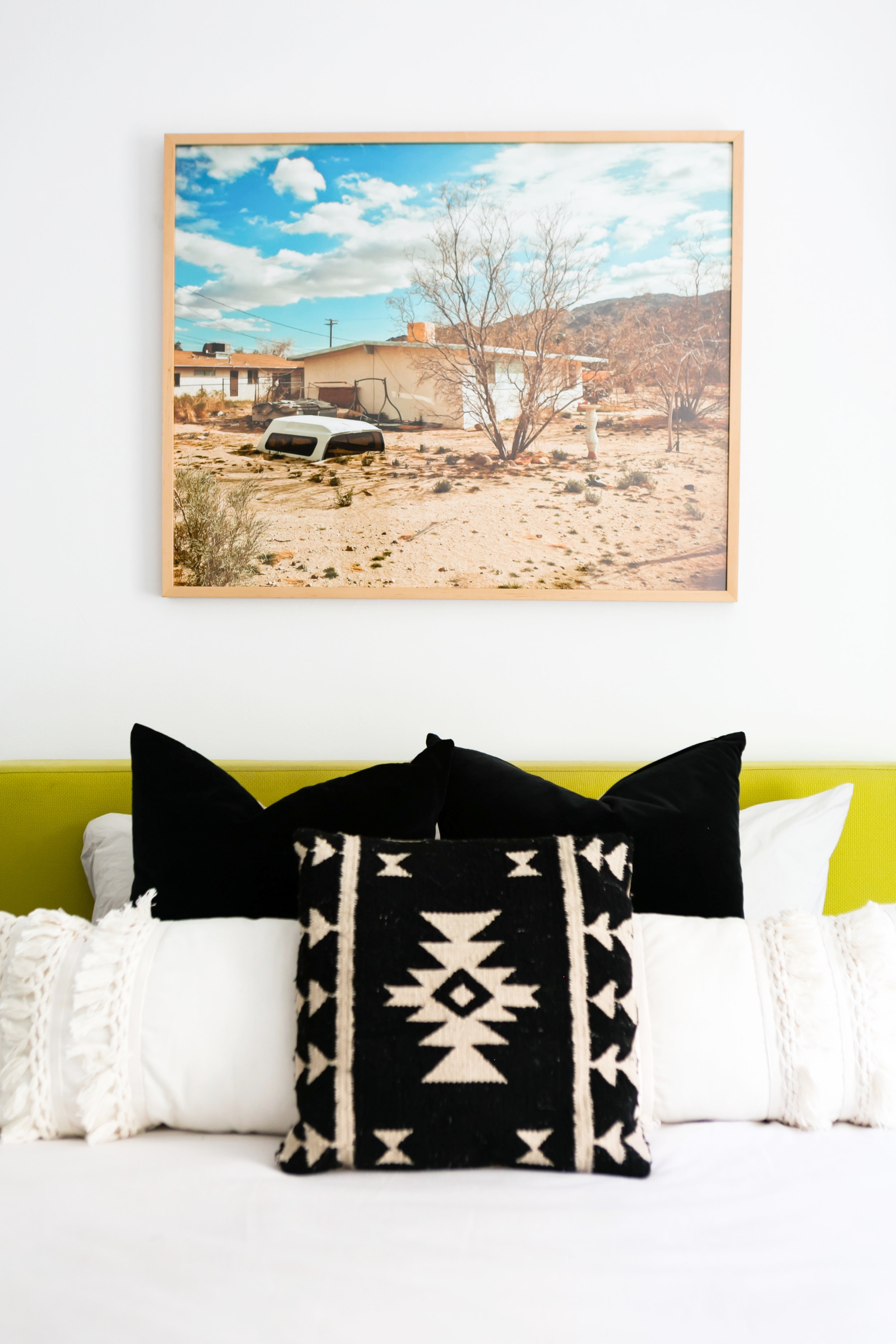 The Guest Room - We wanted to make the guest room feel boho, chic, and comfortable but also wanted to combine some of the items we already had in our house into the mix so the results were a super eclectic mix with brands ranging from Design Within Reach to Target Style. The centerpiece of the room is the photography by Rick Rodney, framed by Framebridge.