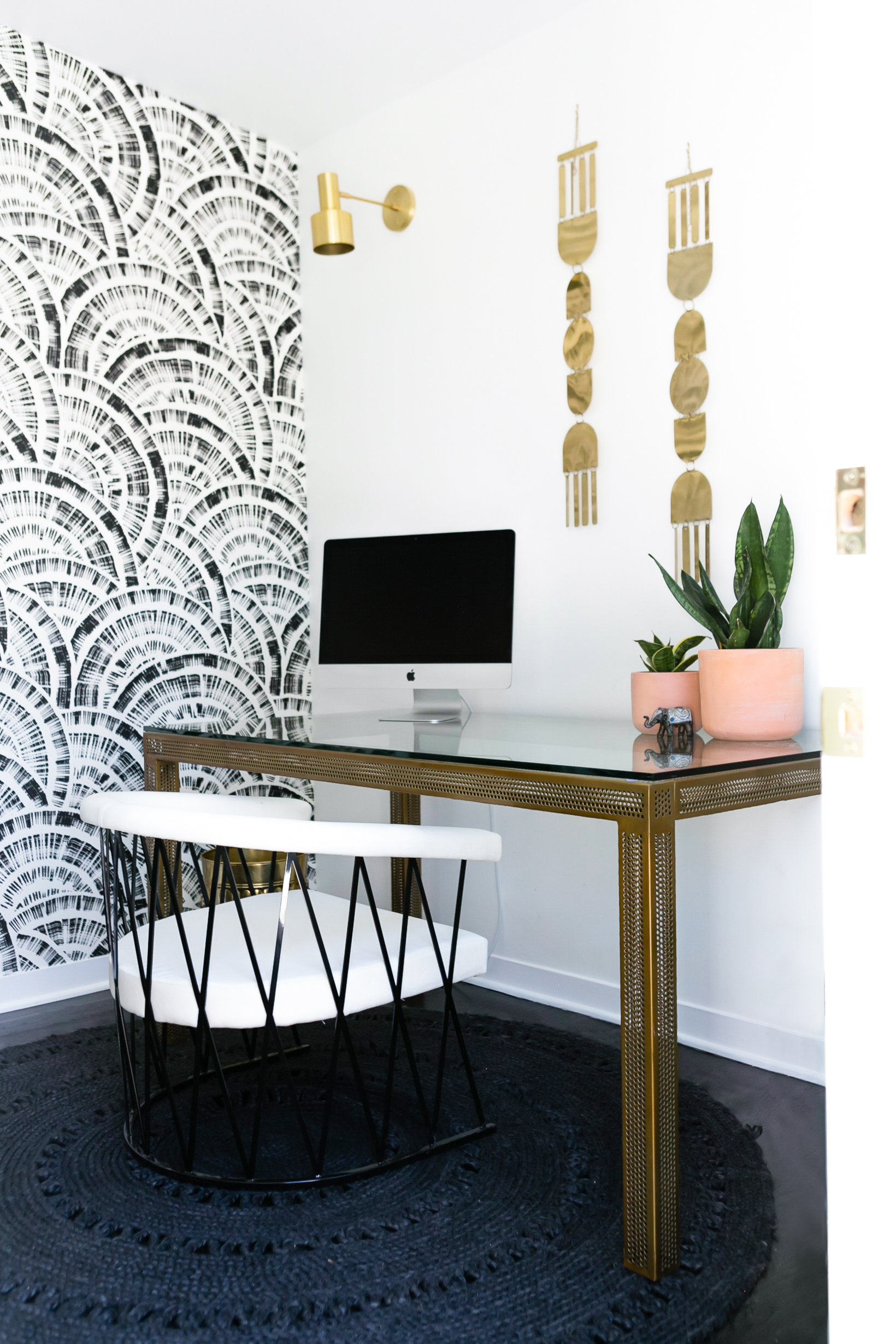 The Home Office - Notably cleaner than my actual office (LOL) I wanted to use this room to create a small little work sanctuary in the home for those weekends where I have to crank out some emails! The color palette was focused around black and gold which was perfect for CB2's collection. The wall hanging is from Target Style and part of the Nate Berkus collection.