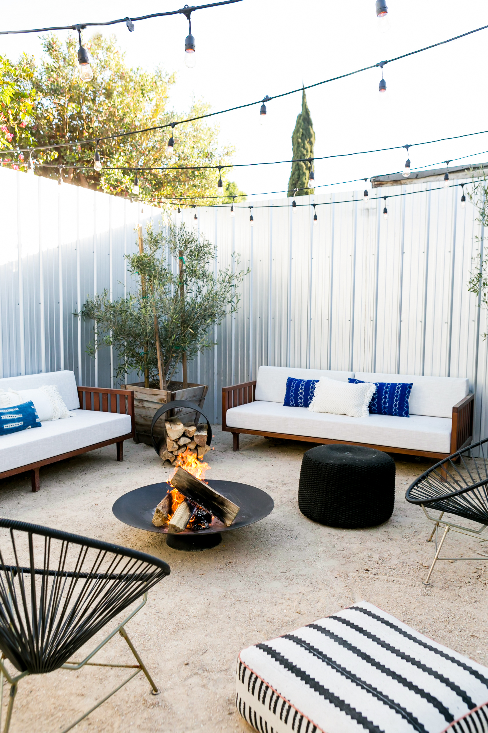 The Outdoor Space - Living in Southern California, we had to take advantage of the outdoor space. One of the best hacks I learned from a friend was using the corrugated metal fencing -- not only is it cheap and durable but it looks amazing! Further we wanted to add some green as we don't have true grass and olive trees are a great way to bring shade and greenery with very little upkeep.