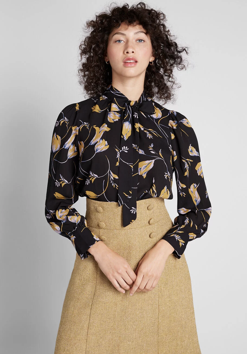 ModCloth Marvel the Masses Tie-Neck Blouse$55 - Wear this black blouse to your next job interview and show them who's boss.