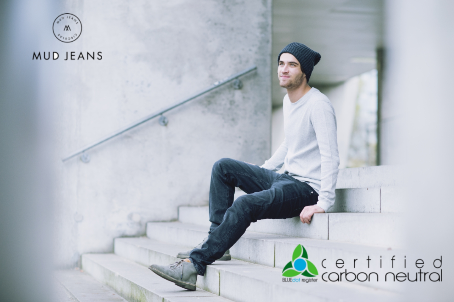 Guy on steps with logos.jpg
