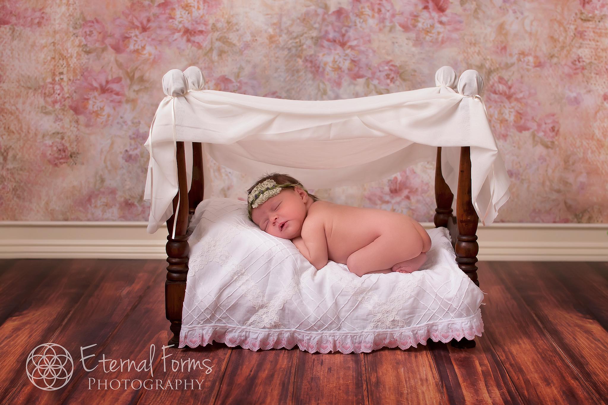 newborn on baby bed
