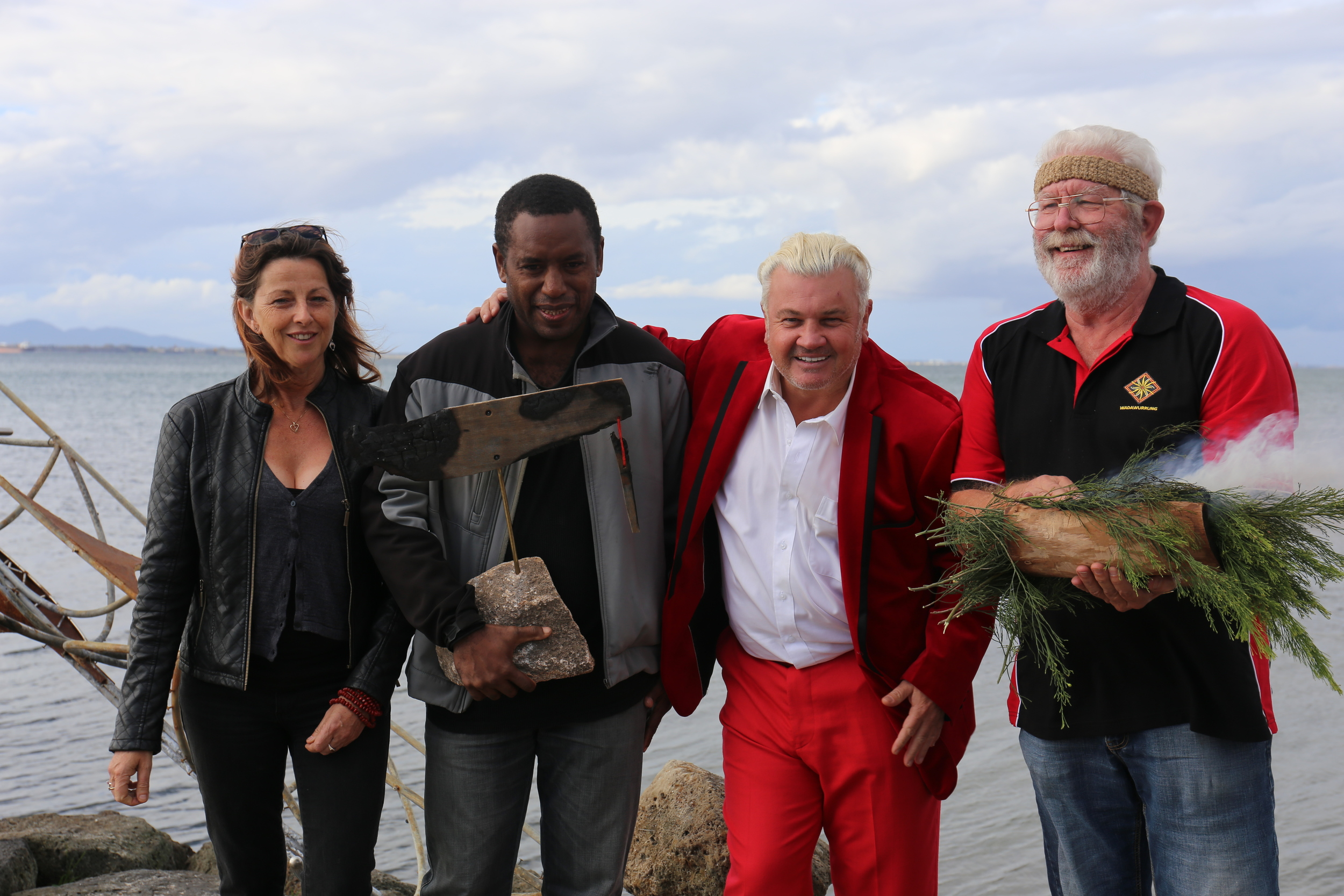 Canoe artists Mahony Maia Kiely and Leonard Tebegetu with Geelong Mayor Darryn Lyons and Wadawurrung Elder Uncle Bryon Powell at the Eastern Beach ceremony.