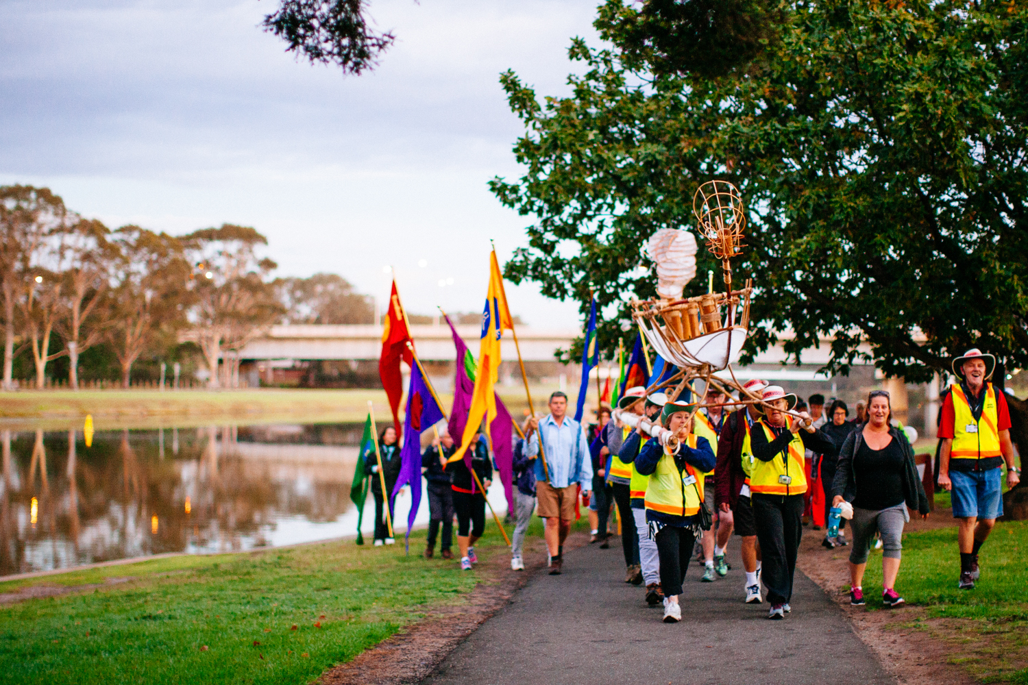 Crossing supervisors carrying Canoe alongside the Barwon River towards Christies Rd.   Image by Dean Walters Photography.