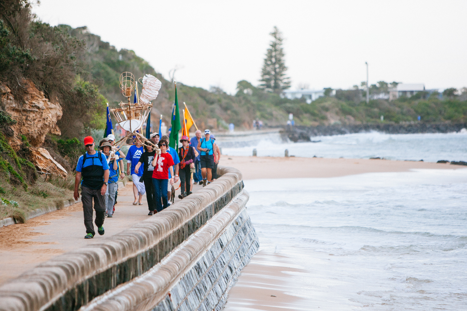 The procession reaches the coast side.   Image by Dean Walters Photography.