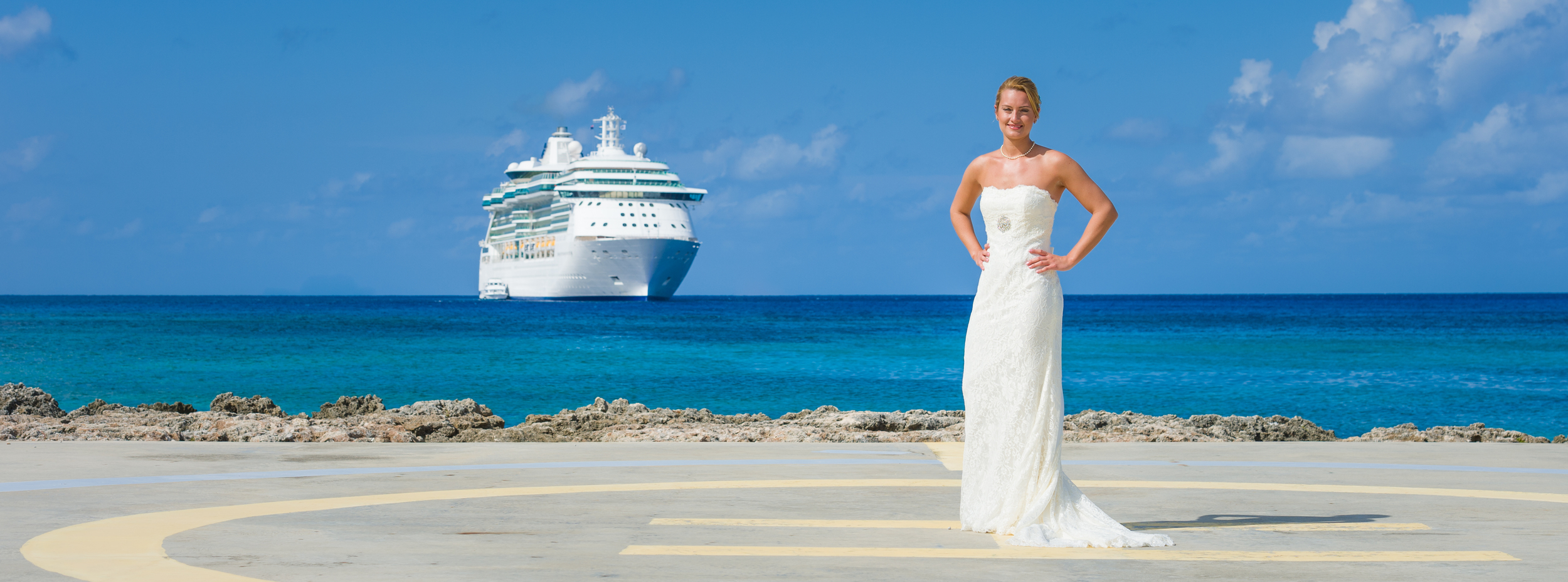 Bride stands on Helipad next to Simply Weddings