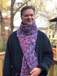 John with Hand-crocheted Alpaca Scarf