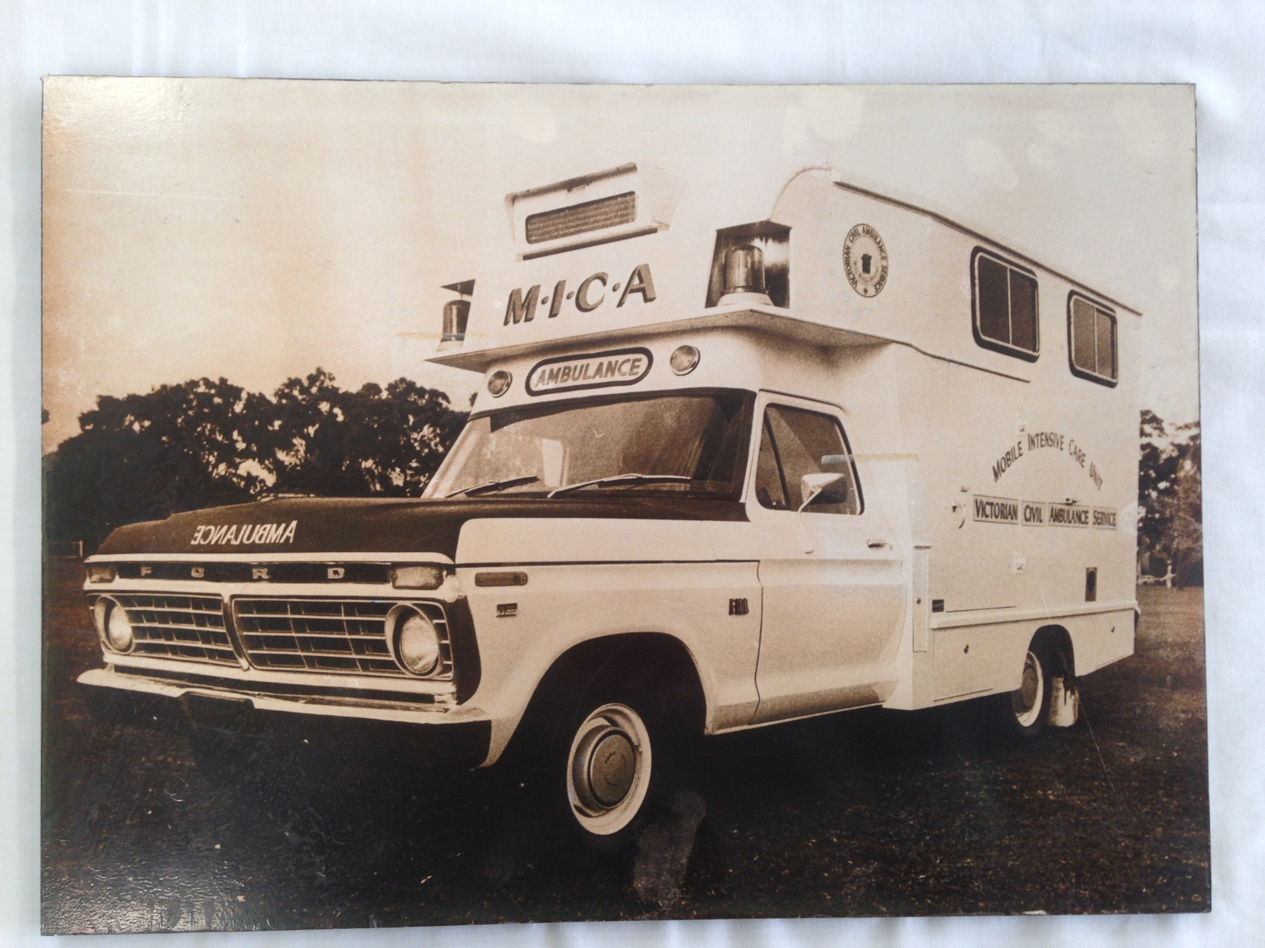 This first MICA ambulance was a retrofitted clinic transport bus in 1971. Mobile Intensive Care Ambulances in Victoria were initiated after the advantage of mobile coronary care units was recognised and a recommendation that ambulance officers receive advanced medical training was accepted.
