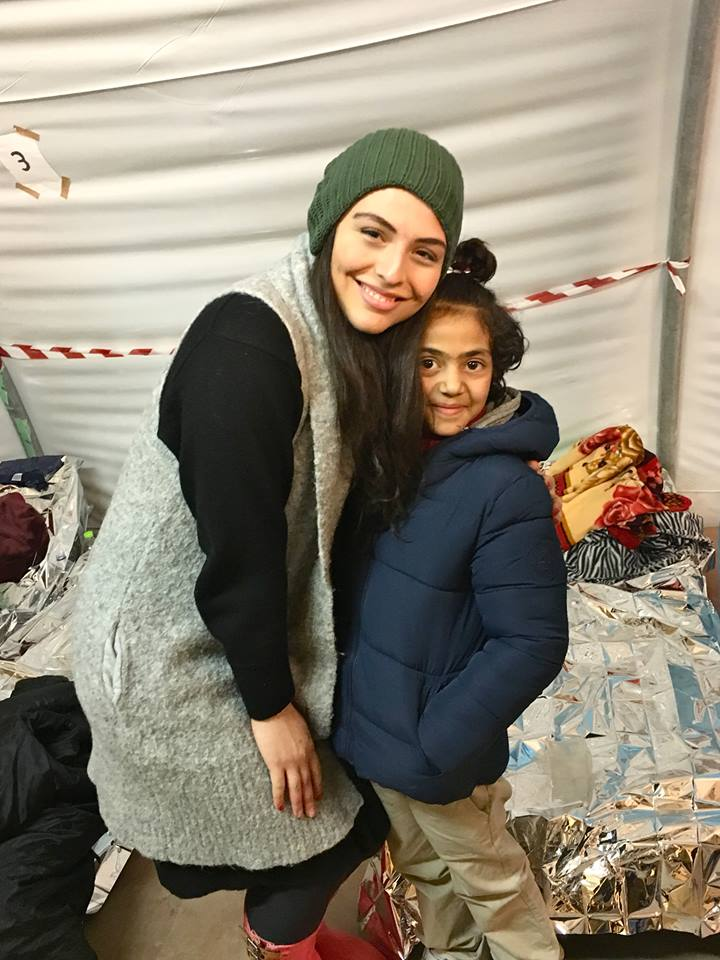 Photo: Aziza and Shams, a Syrian refugee. at a medical clinic inside of a tent at the Moria Refugee camp where Shams' younger sibling was being treated.