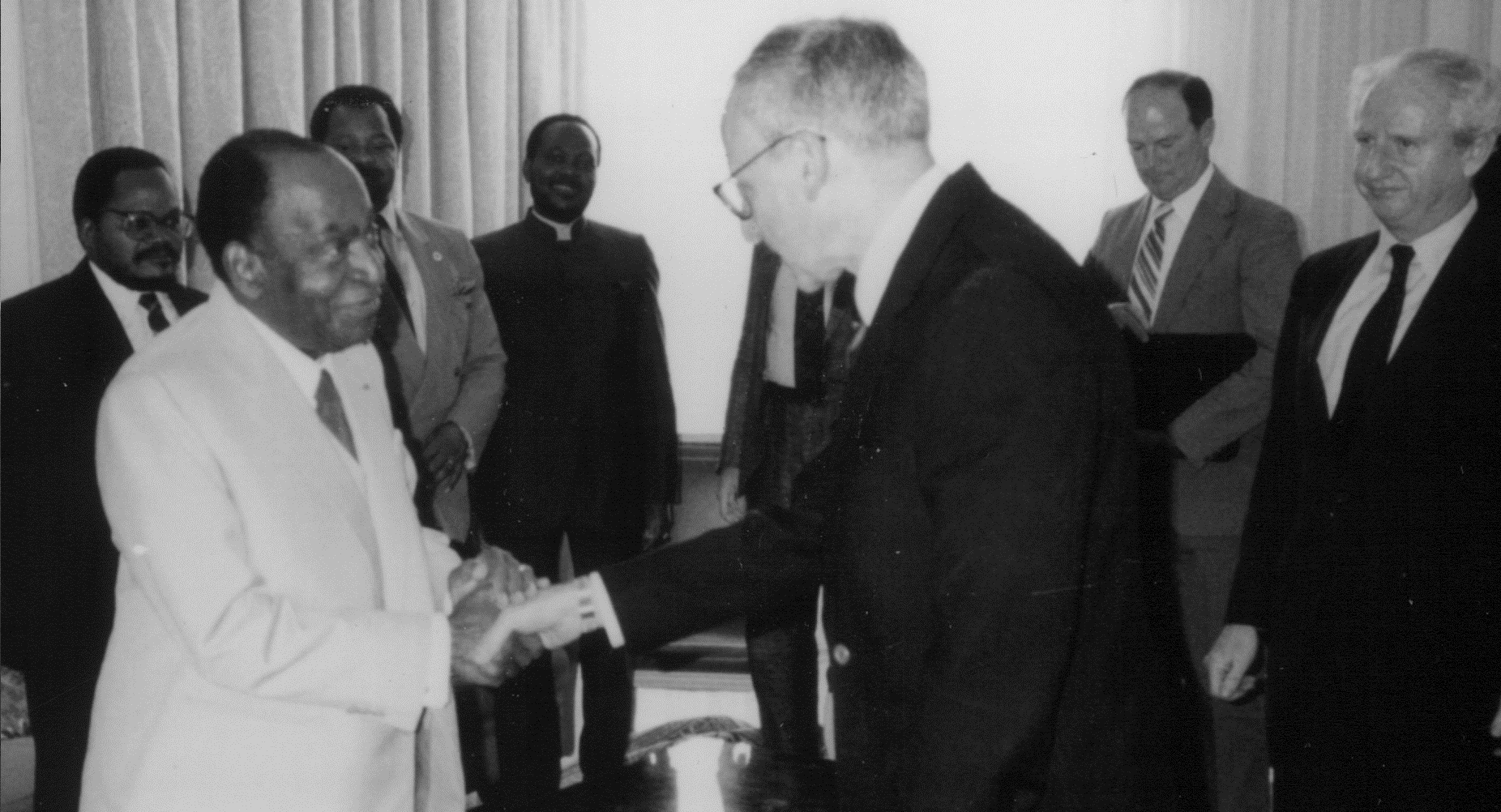 President Félix Houphouët-Boigny of Côte d'Ivoire greets Assistant Secretary of State Cohen in Abidjan(1991).