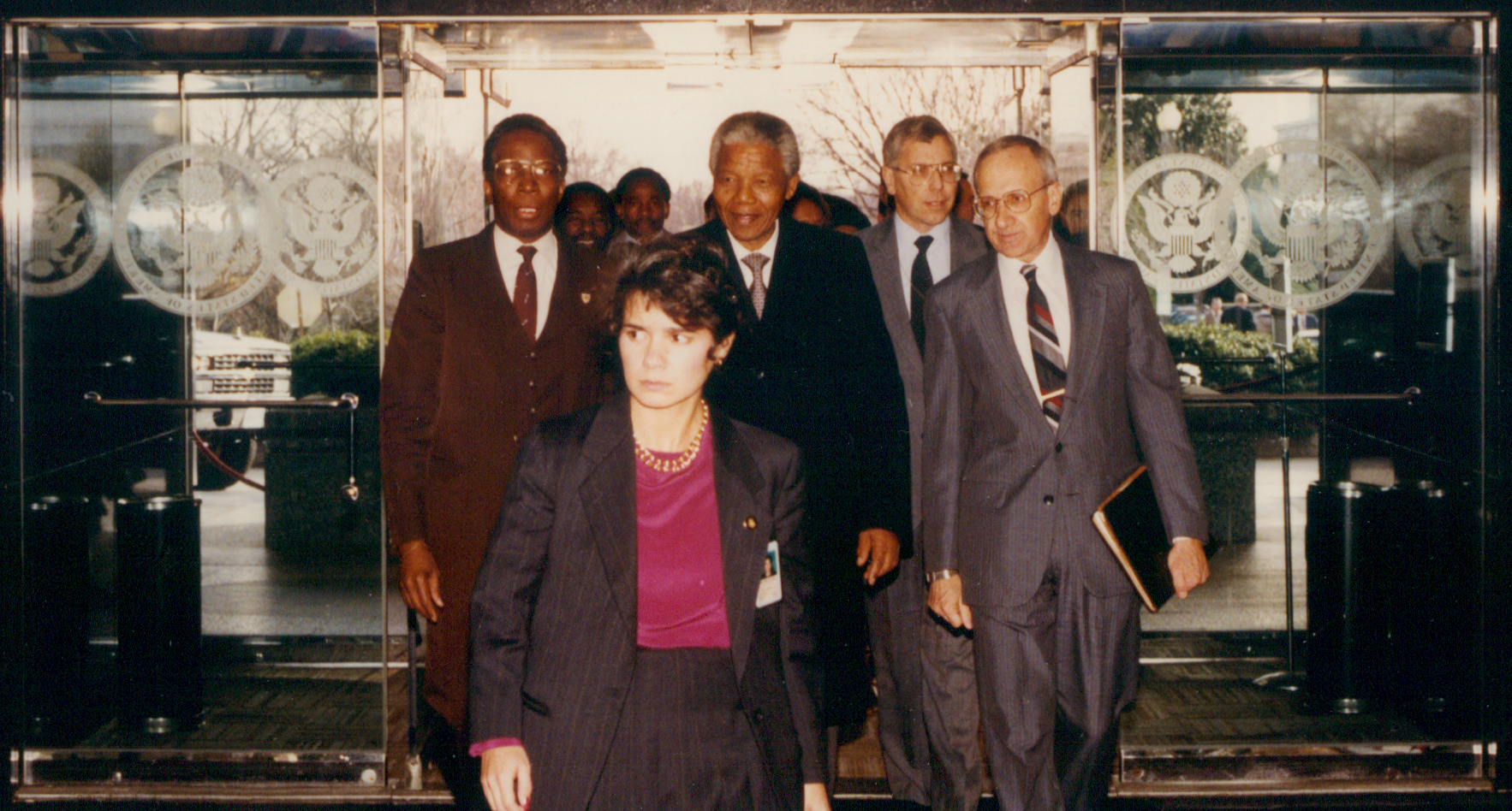 The late South African president Nelson Mandela, recently released after twenty-seven years in prison, enters the State Department with Cohen at the beginning of his first official visit to the United States in March 1990.