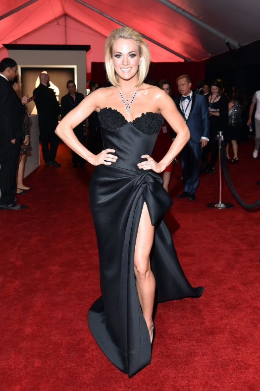 I could've done without the necklace but I think overall Carrie Underwood looked beautiful. I think the dress is classic yet sexy, the hair adds edge to a classic dress and can we talk about her body...Lawd!