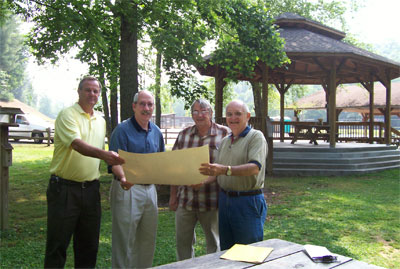 Larry Garrett, Lamar Paris, Mike Smith, and Gene Harrison at the Pavilion in Meeks Park