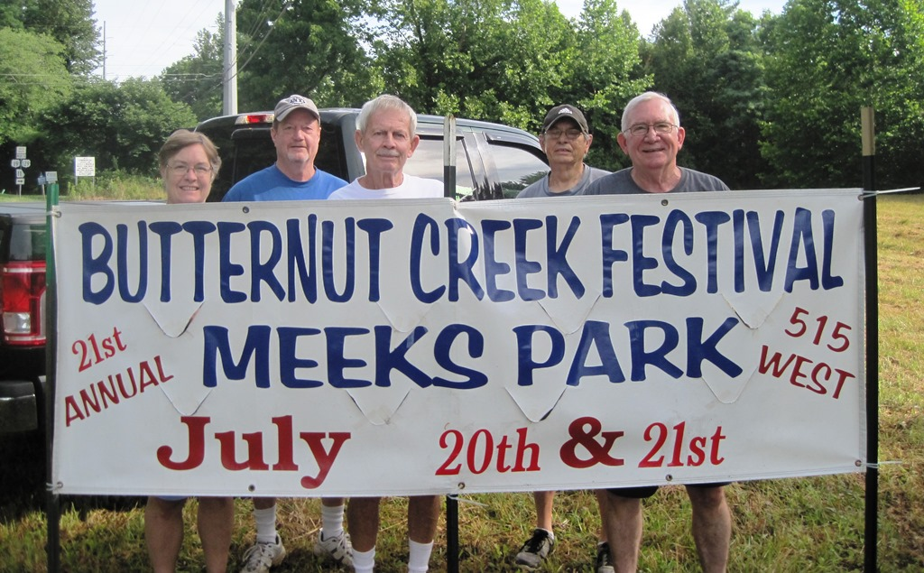 Putting up banners for 2019 Butternut Creek Festival, Leslie & Danny Grojean, Paul Grossmann, Darryl Dover & Tom Chambers.