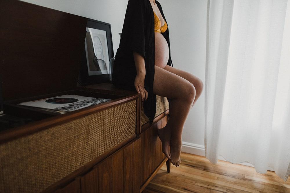 pregnant woman's stomach next to window