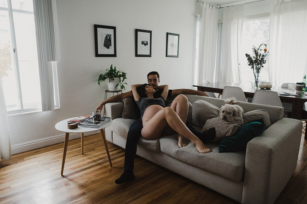 couple cuddling on couch in their living room