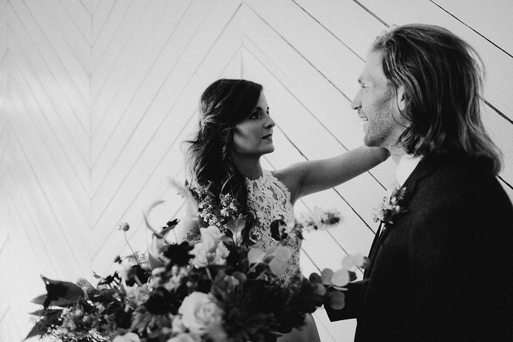 bride fixing groom's hair at wedding