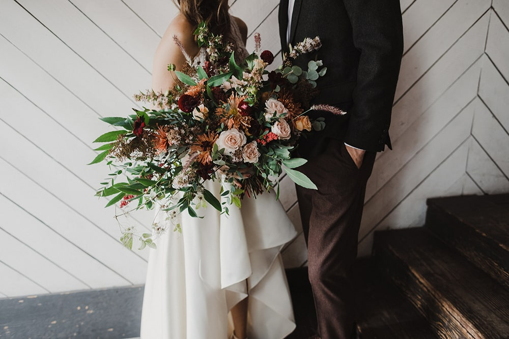 bridal bouquet in bride's hand and wedding dress
