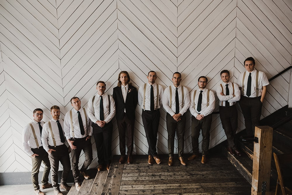 groom and groomsmen posing for photographer at union pine in portland